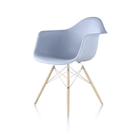 Light blue Eames Molded Plastic Chair with dowel legs viewed at 45 degree angle