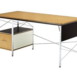 An angled view of an Eames Desk with a neutral color scheme featuring birch, white, and black accents.