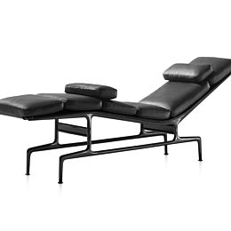 Black leather Eames Chaise lounge chair viewed from the front at an angle